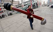 Passionate calligrapher makes 10 feet long ink brush to perform street art